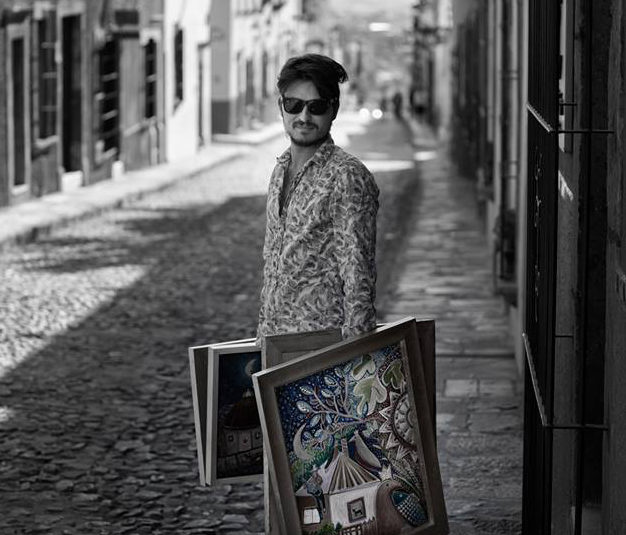 San Miguel de Allende Artist with paintings on the street
